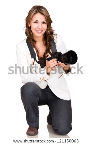 Female photographer holding a professional camera - isolated over white - stock photo