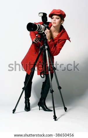 female photographer with camera - stock photo