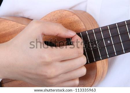 female playing Ukulele - stock photo