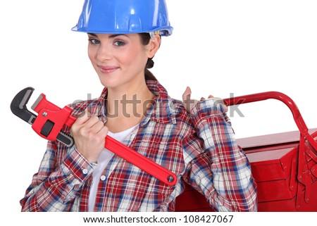 Female plumber ready for her next job - stock photo