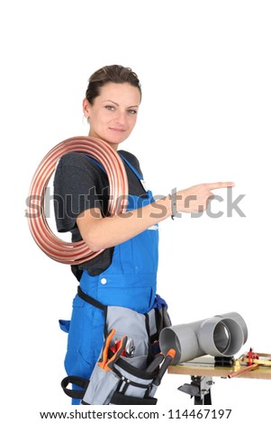 Female plumber with equipment - stock photo