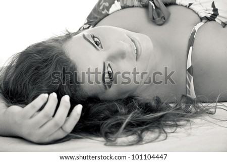 Female Plus size model posing in the studio, face portrait, on white background. The woman is sensual on the floor. Good for concept of health, happiness, dieting, obesity, weight loss. - stock photo