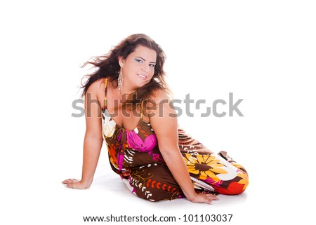 Female Plus size model posing in the studio, full body portrait, on white background. Woman is smiling and sensual on the floor. Good for concept of health, happiness, dieting, obesity, weight loss. - stock photo