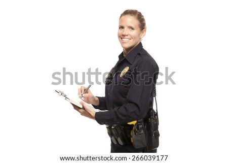 FEMALE POLICE OFFICER   Happy female cop in uniform writing report against white background. - stock photo
