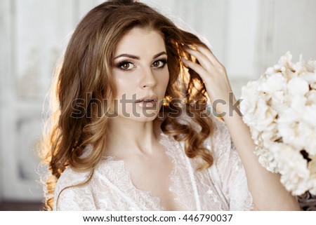Female portrait of cute lady in robe indoors. Close up beautiful sexy model girl in elegant pose. Closeup beauty blonde woman with hairstyle - stock photo