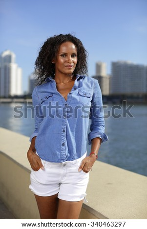 Female posing with hands in her pockets - stock photo