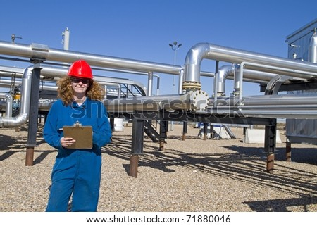 Female production operator conducts inspection - stock photo