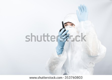 Female professional in hooded suit for bio-hazard protection on white background. - stock photo
