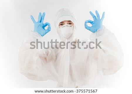 Female professional in hooded suit for bio-hazard protection over white background. - stock photo