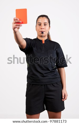 female referee showing the red card - stock photo