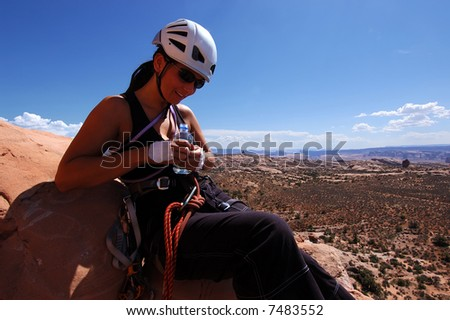 Female rock climber at taking a break - stock photo