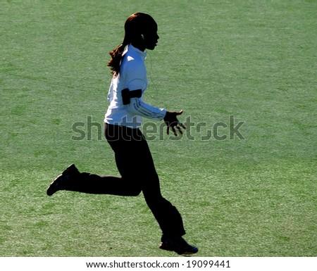Female runner silhouette - stock photo
