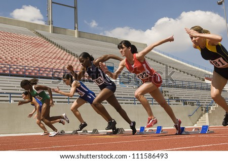 Female runners starting race - stock photo