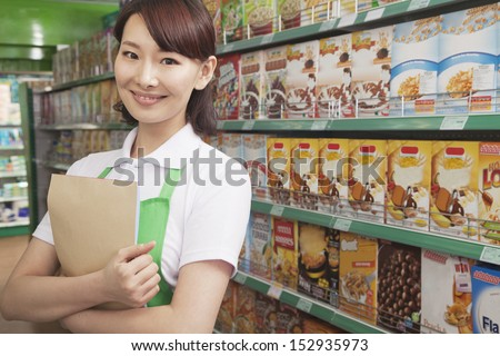 Female Sales Clerk Working in a Supermarket - stock photo