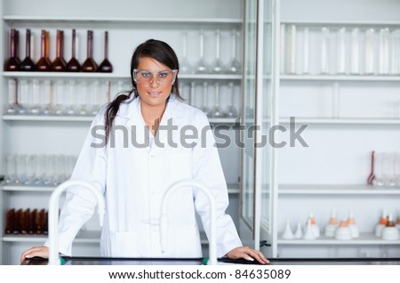 Female scientist in a laboratory looking at the camera - stock photo