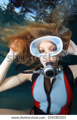 Female scuba diver - stock photo