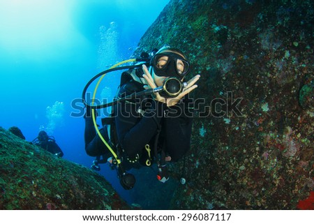 Female scuba diver having fun - stock photo