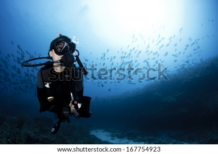Female Scuba Diving in the Ocean - stock photo