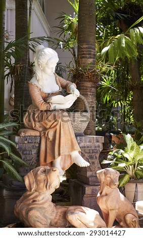 female sculpture in the garden - stock photo