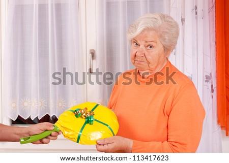 female senior gets an uninspired present - stock photo