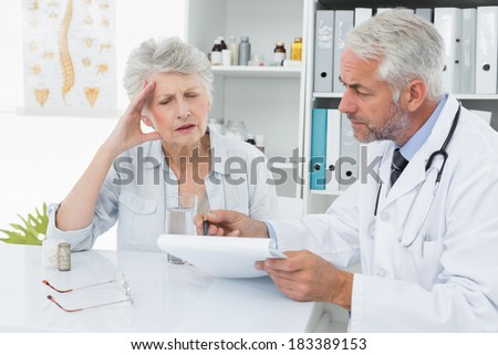 Female senior patient visiting a doctor at the medical office - stock photo