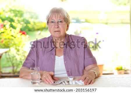 female senior wit a lot of drugs - stock photo