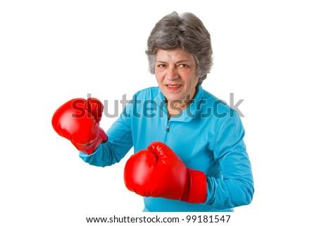 Female senior with red box gloves - isolated on white background - stock photo
