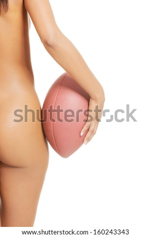 Female sexy right buttock. Close up. She's holding a ball.  isolated on white.  - stock photo