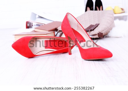 Female shoes and briefcase on floor background - stock photo