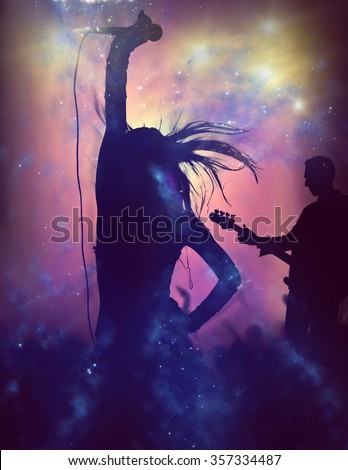 Female singer silhouette at rock concert - stock photo