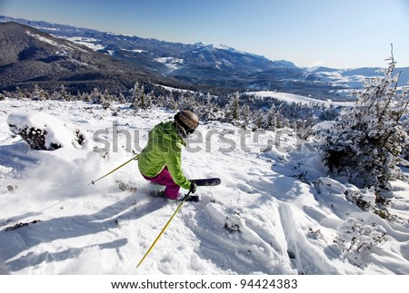 Female skier moving down the slope, free-ride concept - stock photo