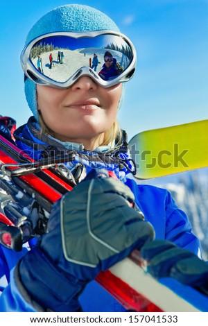 Female skier with ski in the mountains - stock photo
