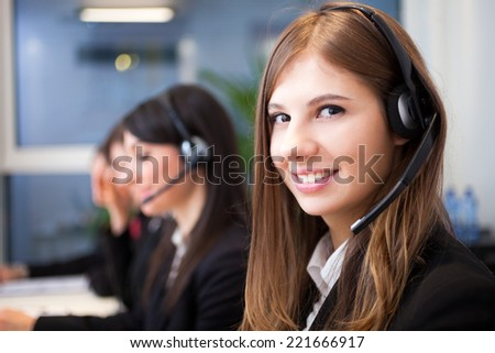 Female smiling customer support operator with headset portrait - stock photo