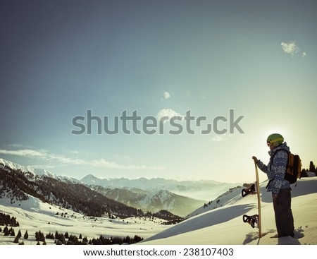 female snowboarder on the background of high snow-capped Alps in Grindelwald, Swiss - stock photo