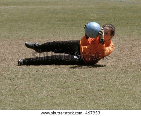 Female Soccer keeper warmes up - stock photo