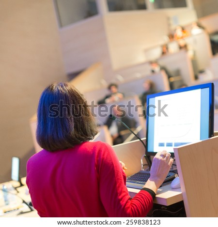 Female speaker at Business Conference. Audience at the conference hall. Business and Entrepreneurship. Business woman. Expert giving a talk on podium at lecture hall. - stock photo