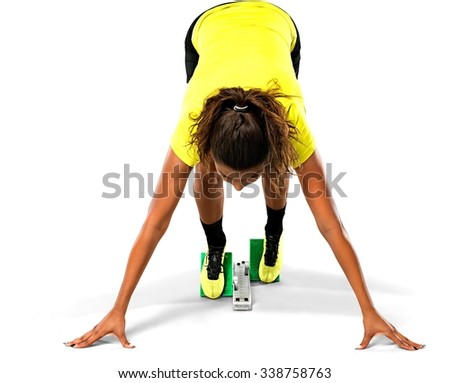 Female Sprinter Getting Ready to Start The Race - Isolated - stock photo