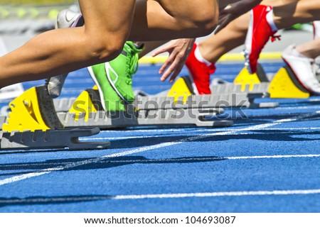 female sprinters start - stock photo