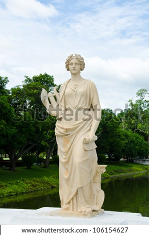 Female  statue made of marble. Decorative gardens of Bang Pa-in Palace, Ayutthaya, Thailand. - stock photo