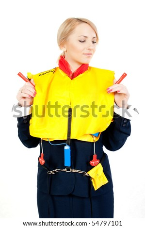 female steward showing how to use a life jacket - stock photo