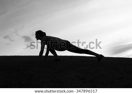 Female stretching at the park - stock photo