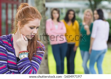 Female student being bullied by other group of students - stock photo