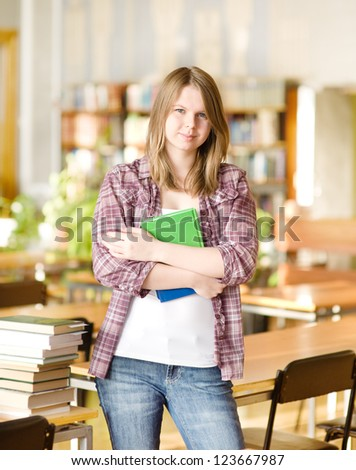 female student in library - stock photo