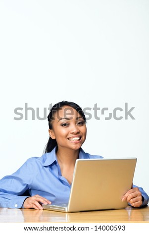 Female student smiles while looking at the camera. Vertically framed photograph - stock photo