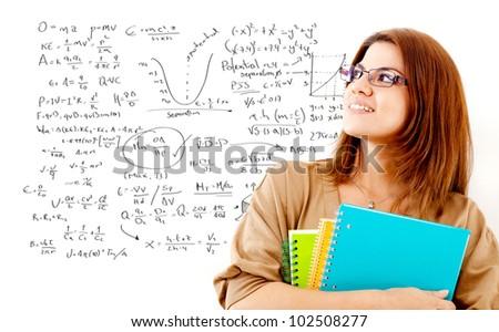 Female student studying maths thinking about formulas - stock photo