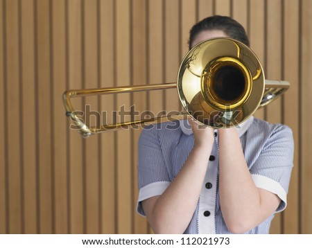 Female student with trombone - stock photo