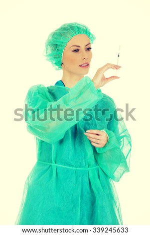Female surgeon doctor with a syringe in hand.  - stock photo