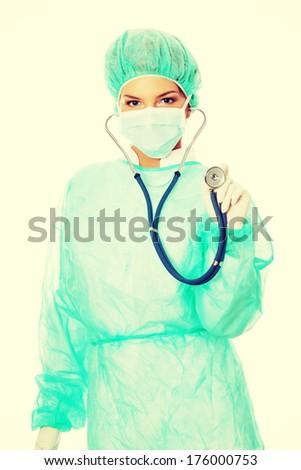 Female surgeon with stethoscope. Isolated on white. - stock photo