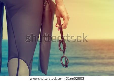 Female swimmer preparing for training in the sea/ocean. - stock photo