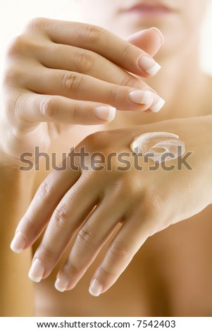 female taking care of her hands - stock photo